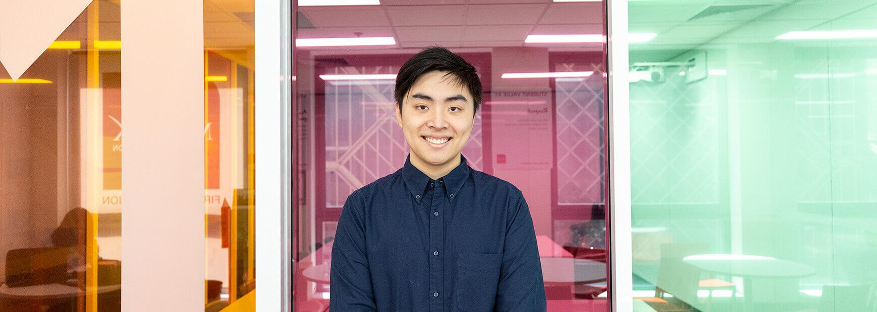 blog-hacks-tim-li-tim-li-hacks-overcoming-time-management-banner-image-tim-standing-smiling-in-front-of-coloured-background