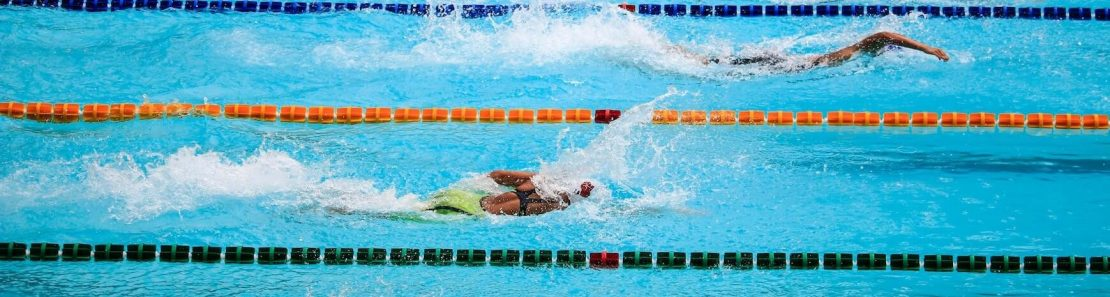 2018 High School Rankings banner image swimmers racing in a pool