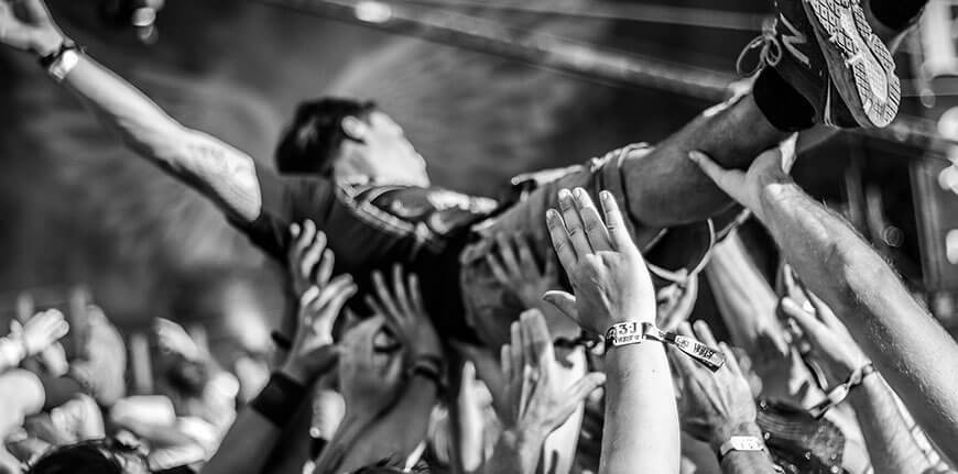 how-to-write-craft-of-writing-creative-audience-black-and-white-shot-of-a-crowd-surfer-at-a-rocking-punk-gig