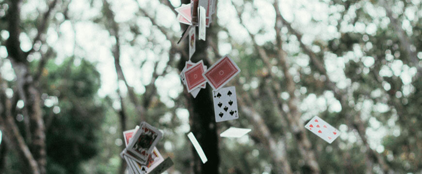 blog-success-secrets-nathans-hacks-how-to-defeat-distraction-to-focus-100%-on your HSC-Tricks-cards-in-air-against-green-trees