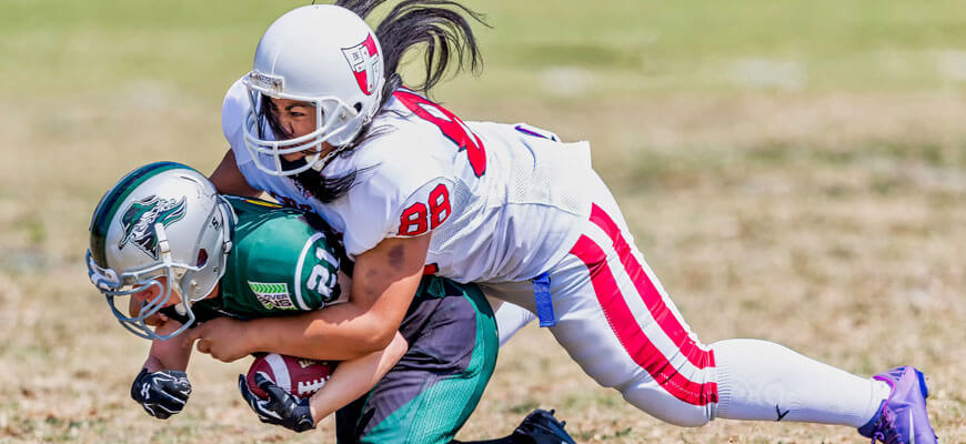 a female grid-iron player absolutely cleaning up a male running back *BOOOM* blog-english-5-comprehension-skills-year-6-students-need-for-high-school-tackled
