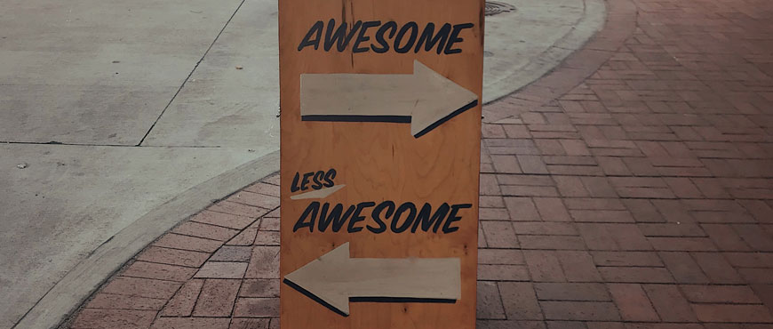 "a sandwich board with ""more awesome"" and 'less awesome"" written on it how-to-write-a-year-6-creative-in-8-steps"