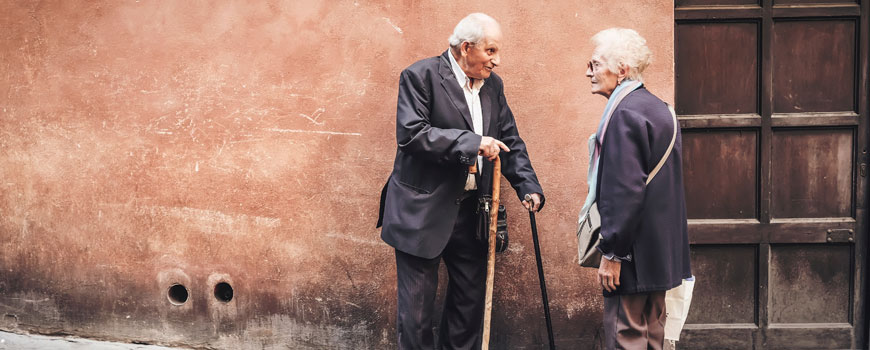 photo of cute old people having a conversation