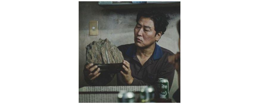 film symbolism of the scholar's stone in Parasite